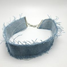 The super on trend Denim Choker is made of cotton and comes in 3 different washes. It has a fully adjustable chain and clasp closure. It is very lightweight and flexible for ultimate comfort. - Free s