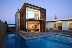 Modern Minimalist House Design Wooden Wall Ideas Surrounded By Pool 16 Modern house design ideas pictures http://seekayem.com
