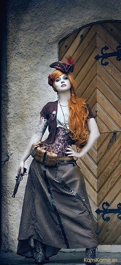 Model, Emy Von Hell, photographed by, Blodroppe. Gunslinging Steampunk Victorian lady posing on beautiful set with rustic door & detailing. Chat Steampunk, Cosplay Steampunk, Mode Steampunk, Style Steampunk, Steampunk Couture, Steampunk Dress, Steampunk Design, Victorian Steampunk, Steampunk Clothing