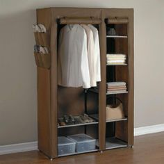 """Brylanehome 7-Shelf Wardrobe by BrylaneHome. $34.99. A BrylaneHome® Exclusive! Interior hanging bar, 2 shelves and racks for 5 pairs of shoes-plus additional outside pockets for 4 more pairs of shoes! Powder-coated steel, fabric cover with zip front. Assembly. 68¾""""Hx43¼""""Wx17¾""""D.. Save 42% Off!"""