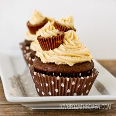 Peanut butter ball stuffed chocolate cupcakes with pb buttercream frosting.