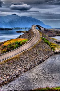 Atlantic Ocean Road — Averøy, Norway. The route was originally proposed as a railway line in the early 20th century. The land was later adopted for public road use in the 1970s, and construction began in 1983.