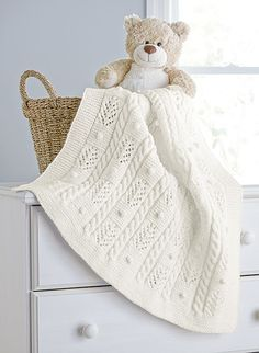 A soft and snuggly blanket for your baby. This 2nd place winner is designed by Izabella Tichy. Shown in Aran Irish Twist.