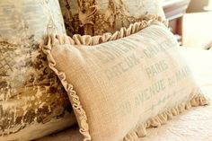 Toile and burlap. Soft gray/blue and cream color palette is perfect.