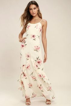 Lulus Exclusive! The Bring the Rain Cream Floral Print Maxi Dress has us blooming with love! Lightweight chiffon with a berry pink, beige, and green floral print falls from adjustable spaghetti straps into a princess seamed bodice. Fitted waist tops a cascading maxi skirt with ruffled tier. Elasticized back for fit with hidden zipper/clasp.