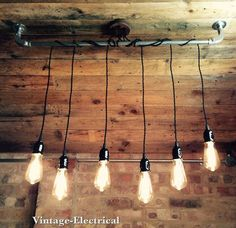 INDUSTRIAL 6 x CEILING LIGHT FITTING WITH AN ANTIQUE VINTAGE FEEL TO IT. 6 x HANGING FABRIC CABLE, WITH VINTAGE STYLE BAKELITE HOLDERS 6 x E27: