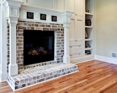 Love this and the floors for the living room. We already have the built ins and the brick fire place. =) White Wash Brick Fireplace, Brick Hearth, Painted Brick Fireplaces, Brick Fireplace Makeover, Fireplace Hearth, Fireplace Remodel, Fireplace Surrounds, Fireplace Design, Fireplace Ideas