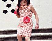 Black Jumper Dress with Polka Dot Cascading Flounce Ruffle. $34.00, via Etsy.
