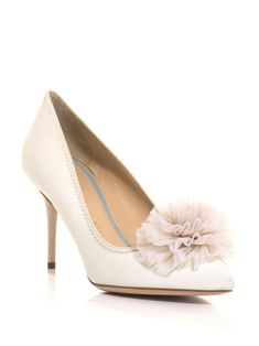 e6121c0e1bc An ivory silk-twill shoe with a point-toe and an ivory leather mid-high  heel.The slip on shoes have an ivory leather pinked edge detail with an  ivory tulle ...