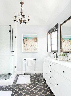 black fishscale tile floor creates a bold accent in this bathroom