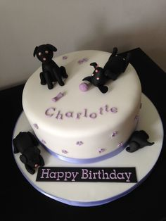 Puppy birthday cake. Lots of black puppies for a girl who loves her black labrador
