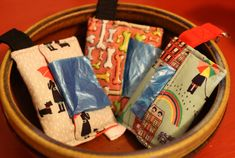 """Theyre here, the adorable poop bag holders from Puppy Pawz Boutique. I bet you never thought you'd hear """"adorable"""" and """"poop bag"""" in the same sentence. These bags are lightweight and stylish and easy to carry in your pocket, attach to your leash, belt loop, key ring, purse and more. Great for the park, walks, hikes, travel anywhere and any time! Made with 100% cotton prints with complimentary interior fabrics. Lined with fusible interfacing for sturdiness and durability. Each piece is made…"""