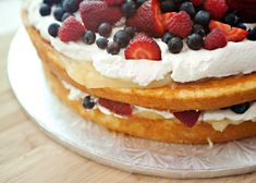 Fruit Basket Cake recipe - I will most definitely make this Fruit Basket Cake again.  It is so fresh tasting and light and gorgeous.  I will just fix my structural problem.  I would make this and bake it in 9 inch pans and make the cake really tall.  It will be gorgeous. #cake #berry #dessert #holiday
