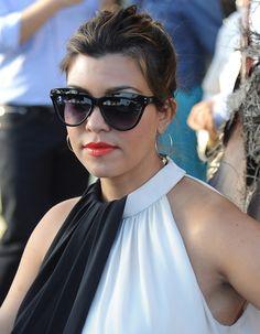 Kourtney Kardashian rocks tangerine lips with a black and white outfit!