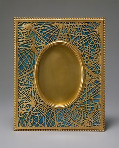Gilt bronze and favrile glass frame designed by Louis Comfort Tiffany (American, New York City 1848–1933 New York City) and made by Tiffany Studios (1902–32), ca. 1905–20