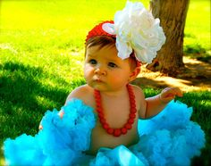 Only one of the cutest baby girls ever, and wearing an adorable flower in her hair!