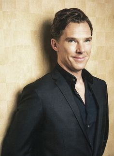 Black shirt with black suit looks sexy (he said it, not me, but who am I to disagree?)