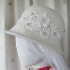 Hand blocked wool felt ivory cream cloche 1920s style hat featuring an embroidered lace motif with delicate flower shaped beads