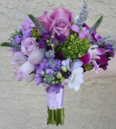 Purple wedding bouquet flowers,with light purple stock dendrobium orchids roses touch of mini green hydrangea lavender freesia and veronica