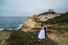 Cute wedding photo of the bride and groom hugging after their ceremony up on Cape Kiwanda on the beautiful Oregon coast in Pacific City. It was an awesome and unique spot for a wedding ceremony!