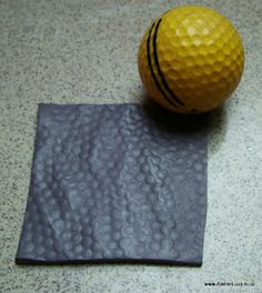 Texture polymer clay with household items: golf ball, basket, long bolt, etc. Lots of neat ideas for creative texturing!