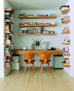Floating shelves library and working desk in a midcentury style