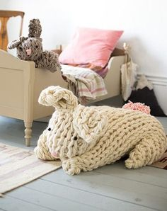 Free knitting pattern for Giant Arm Knit Bunny floor pillow