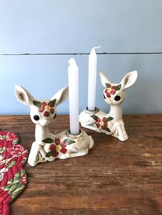 This is a super sweet pair of vintage candle holders! They are cute little deer that are hand painted and decorated with poinsettia flowers and leaves. These would look amazing tucked into some greens at Christmas time or on your shelf day to day!  They hold 3/4 Taper candles or 1 with the skinnier bottoms. MARKINGS ---------------  • Hand painted • Star • Japan  CONDITION -----------------  This is in good vintage condition with a wee bit of wear (shown in closeup) that is not super obv...
