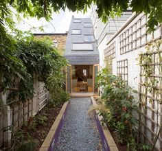 Trellis-lined gravel path. Turn a narrow row-house back lot into an enchanting allée by lining the walls with wood trellises and climbing plants. A gravel path is an affordable and chic way to finish the space.
