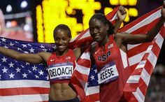 Bronze medalist Janay DeLoach and gold medalist Brittney Reese celebrate their wins in the women's long jump.