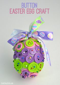 Button Easter Egg Ornament Craft  - so easy. Buttons, push pins and foam egg. Great boredom busting craft for kids!!! Bebe'!!! Darling for Easter!!! But I would use glue to attach the buttons!!!