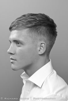 High short back & sides with neat side-brushed top and clean shaven. For the boy