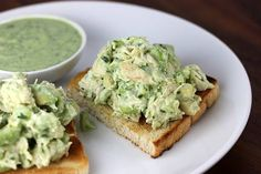 Avocado Chicken Salad: 2 or 3 boneless, skinless chicken breasts 1 avocado 1/4 chopped onion juice of 1/2 a lime 2 Tbsp cilantro salt and pepper to taste. Cook chicken breast until done, let cool, and then shred. Mix with all other ingredients.