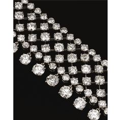 FROM THE COLLECTION OF THE HON. DAISY FELLOWES Diamond choker, the band of trellis design set with circular-cut diamonds in claw and collet settings, suspending a fringe of similarly-cut stones, mounted in platinum, signed Monture Cartier.