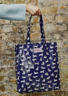This classic oilcloth book bag is puppy perfect for day trips, shopping trips, library trips and more. See more of the sausage dog collection on our website.