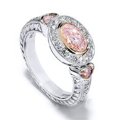 Platinum & Gold Retro-Antique Ring with Light Pink Oval Diamond This platinum and gold retro-antique ring features a center bezel set  GIA certified .69 carat  light pink oval cut diamond.  [...]