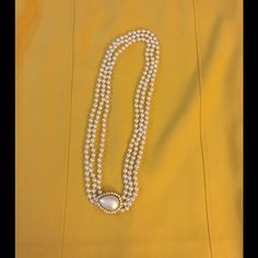Great, 3 strand pearl necklace with focus piece Perfect necklace to dress up any outfit. Jewelry Necklaces