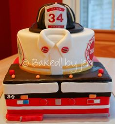 A retirement cake for Captain Stan Pavilonis with the Chicago Fire Department. Both cakes are chocolate with vanilla Swiss meringue buttercream, covered and decorated with marshmallow fondant. The helmet is made from rice krispie treats and. Retirement Celebration, Retirement Cakes, Retirement Parties, Retirement Countdown, Retirement Ideas, Marshmallow Fondant, Firefighter Birthday Cakes, Fire Cake, Fire Fighter Cake