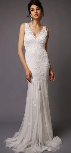 Gorgeous sleeveless v-neck embroidered wedding dress; Featured Dress: Virgos Lounge