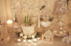 My Romantic Home: Christmas in White! Love this idea. The little house in the apothecary jar looks like a snow globe. What a pretty scene.
