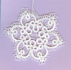 shuttle tatted snowflake design number 6 can be by donatajones, $7.50