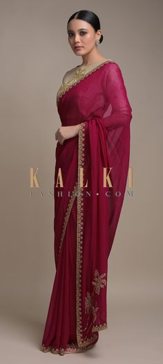 Buy Online from the link below. We ship worldwide (Free Shipping over US$100)  Click Anywhere to Tag  Raspberry Red Saree In Georgette Adorned With Cut Dana Embellished Border Online - Kalki Fashion  Raspberry red saree in georgette adorned with cut dana embellished border.Paired with a contrasting beige blouse with cut dana embellished tree motif.Crafted with round neckline and half sleeves.