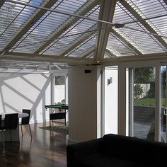 The New England Shutter Co offer custom-made conservatory window shutters to screen conservatory roofs, glass buildings and lantern lights. White Shutters, Wooden Shutters, Window Shutters, Blinds For Windows, Curtains With Blinds, Window Blinds, Conservatory Roof Blinds, Conservatory Lighting, Conservatory House