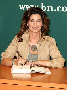 Shania Twain signs copies of her memoir From This Moment On – in which she discusses her devastating divorce
