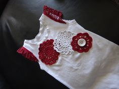 Shot glass doily's with a lace sleeve trim on a plain white singlet. Revamping old baby clothes. Too cute!