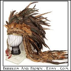 Gypsy Children.... Feather Mohawk in Earthy Colors with Metal Gypsy Veil. $299.99, via Etsy.