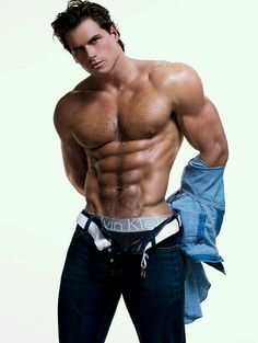 Hot guy with unbottoned jeans showing us that he is wearing some calvin klein boxers underneath his jeans. He also has sexy muscular biceps that look really good and it all goes together great. Love this picture and the hot guy in it!