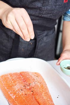 Place the salmon fillet skin-side down in a 9x13 baking dish and season with salt and pepper.