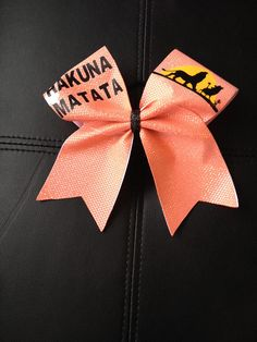 Hakuna Matata cheer bow by Fliptastic Bows Disney Cheer Bows, Cute Cheer Bows, Cheer Hair Bows, Girl Hair Bows, Volleyball Bows, Cheerleading Outfits, Cheerleading Stunting, Cheerleading Quotes, Cheer Quotes
