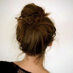 Messy French Bun: The high bun trend isn't going anywhere, so learn how to toss one on top with this easy tutorial. Just pull your hair straight up and twist it like a unicorn horn before your wrap it around itself to finish. (via A Cup of Jo)